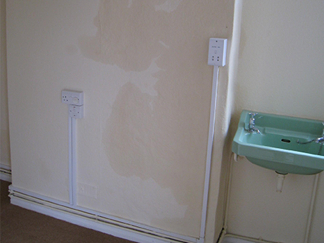 Hygroscopic Salt Contamination shown affecting the plaster on a wall